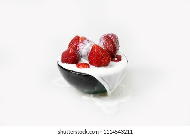 Strawberry in milk on gray background