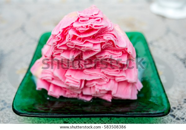 Strawberry milk shaved ice looks like snow In green dish