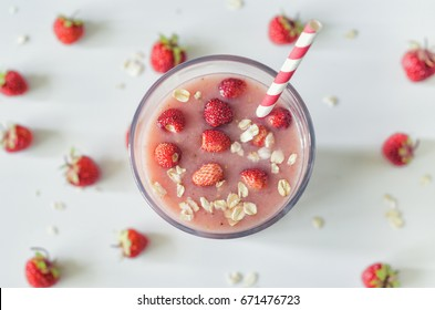 Strawberry milkshake in the glass. Strawberry smoothies with banana and oatmeal. Top view