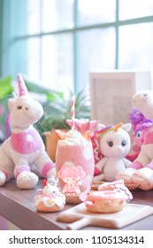 Strawberry milkshake. A glass of strawberry smoothy and a pink teddy bear on the background. Sweet pink unicorn party for little girl birthday party.