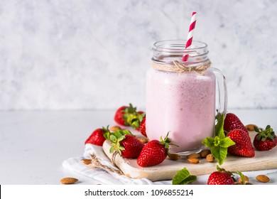 Strawberry milkshake or smoothie.
