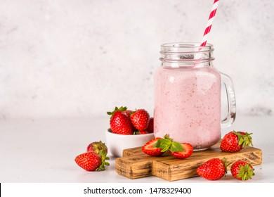 Strawberry milkshake or smoothie in mason jar. Summer dessert. Healthy diet food.