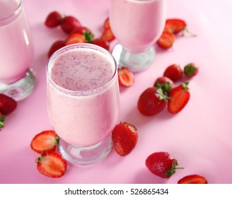 Strawberry milkshakes on color background
