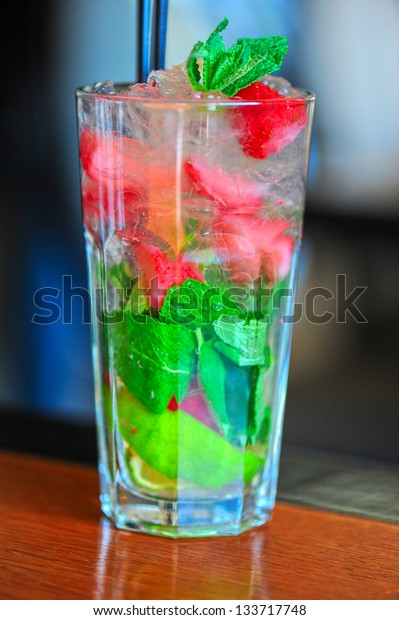 Strawberry mohito cocktail with ice and mint