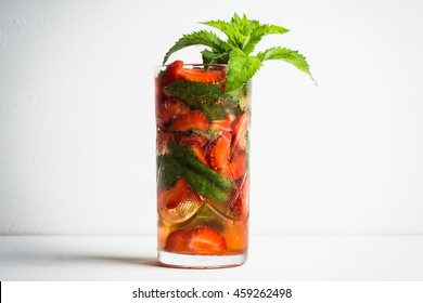Strawberry mojito cocktail on the wooden background