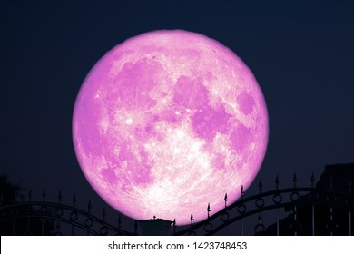 strawberry moon on night sky back silhouette stainless steel iron fence, Elements of this image furnished by NASA
