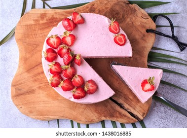 Strawberry Mousse Cake. Homemade Strawberry Cake with fresh berries on the wooden background.
