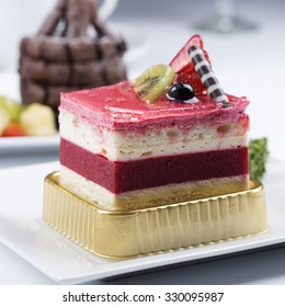 Strawberry Mousse Cake on the white Plate