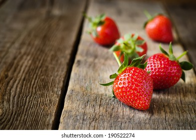 strawberry on a dark wood background