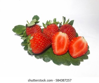 Strawberry on own green leaf isolated on white background