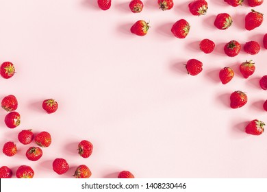 Strawberry on pastel pink background. Flat lay, top view