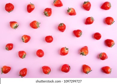 Strawberry on pink background, top view. Berries seamless pattern. Strawberry flat lay on pastel pink background. Creative food concept