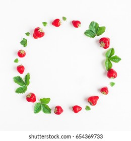 Strawberry on white background. Creative round frame made of strawberry. Summer concept. Flat lay, top view, square.