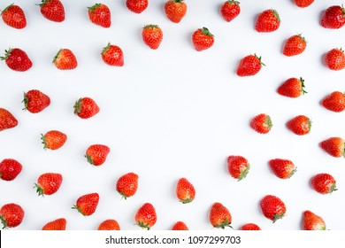 Strawberry on white background, top view. Berries pattern, flat lay. Frame made of fresh strawberry on white background. Creative food concept.