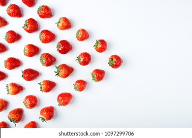 Strawberry on white background, top view. Berries pattern. Fresh strawberry isolated on white background. Creative food concept. Flat lay, copy space