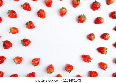 Strawberry on white background, top view. Berries pattern. Frame made of fresh strawberry on white background. Creative food concept. Flat lay, copy space