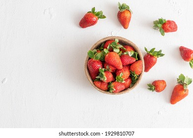 Strawberry on white background, top view.