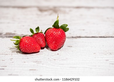 Strawberry on a white wood background. selective focus on strawberries.