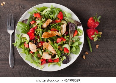 Strawberry Orange Honey Balsamic Salad on spring baby greens and spinach top view
