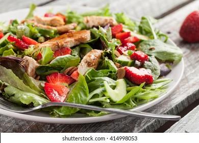 Strawberry Orange Honey Balsamic Salad on spring baby greens and spinach horizontal shot