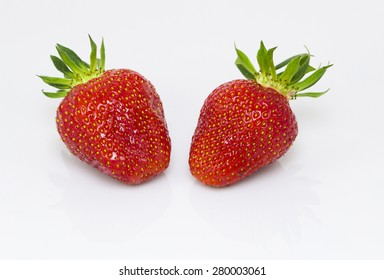 Strawberry pair isolated on white background