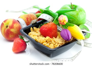 strawberry, peach, apple, kiwi fruit, tulips and flakes in a bowl isolated on white