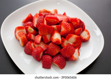 Strawberry pieces on a plate.