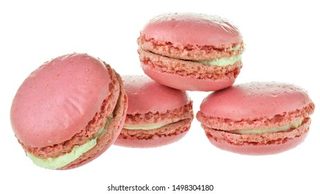 Strawberry pink macaroon closeup isolated on white background.