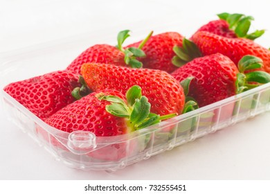 strawberry in plastic box of packaging for sale on white background