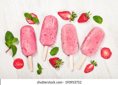 Strawberry popslice icecream on light wooden background