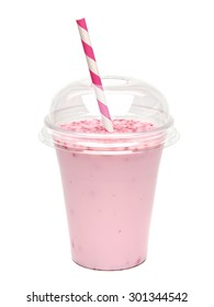 Strawberry or raspberry milkshake in takeaway cup with straw on white background