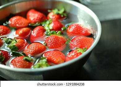 strawberry red ripe fruit cleaning water prepare food cooking in stainless bowl kitchen wares