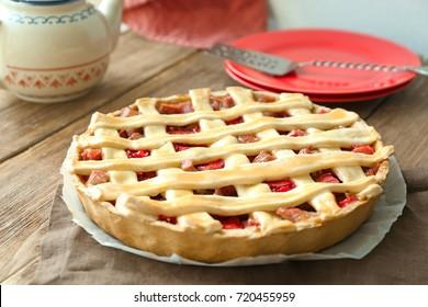Strawberry rhubarb pie on table