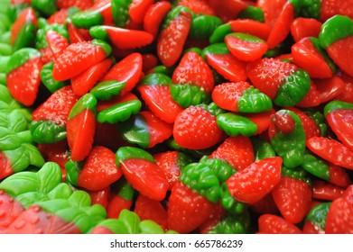 Strawberry shaped fruit candy background