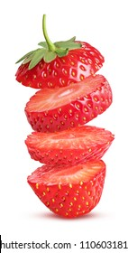 Strawberry slices flying in the air isolated on white background. Clipping Path. Full depth of field.