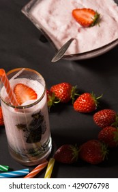 Strawberry smooothie with straberries in the background. High resolution image.