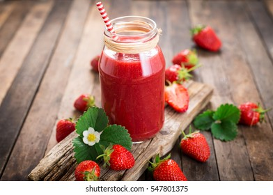 Strawberry smoothie in the glass jar