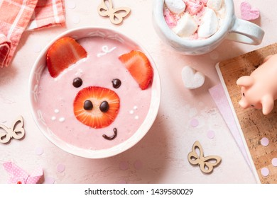 Strawberry smoothie look like a pig for kids breakfast