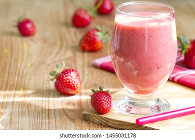 Strawberry smoothie with raw fresh berry on sun