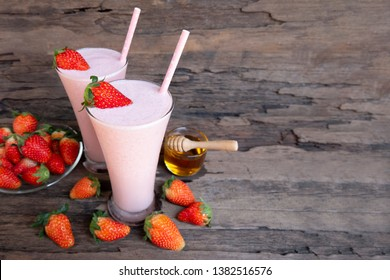 strawberry smoothies colorful fruit juice milkshake blend beverage healthy high protein the taste yummy In glass,drink episode morning on wood background.