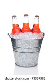 Strawberry Soda Bottles in a Bucket Filled with ice. Vertical Format over a white background with reflection