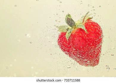 Strawberry in sparkling water closeup