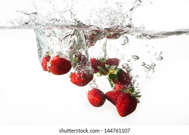 Strawberry splash in water with a white background