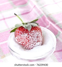 strawberry in sugar on the tablecloth