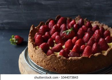 Strawberry tart on a black background