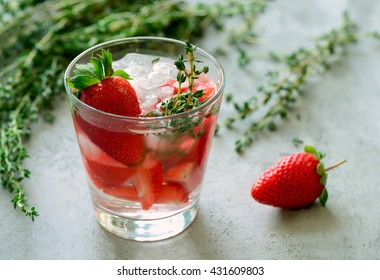 Strawberry and thyme cocktail, alcoholic or non-alcoholic drink or infused water