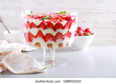 Strawberry trifle dessert in a dish on table