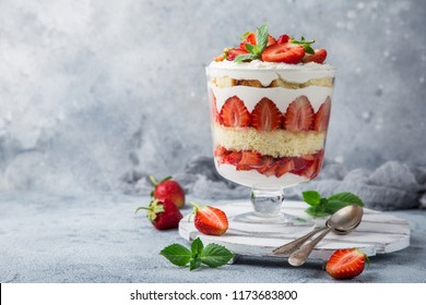 Strawberry trifle. layered dessert with fresh berry and cream cheese, selective focus