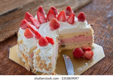 Strawberry And Vanila Ice Cream Cake With Fresh Strawberry Topping On Wooden Table. Selected Focus.