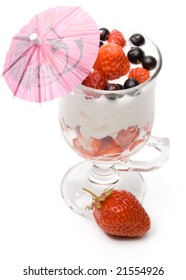 Strawberry with whipped cream in a glass on a white background